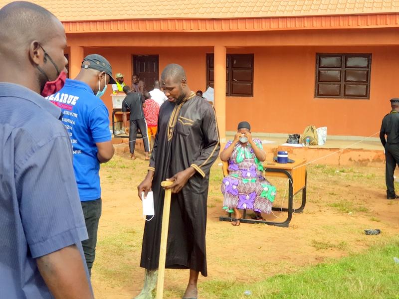 Two PDP loyalists at Philip Shaibu's polling unit (Credit: Yusuf Akinpelu)