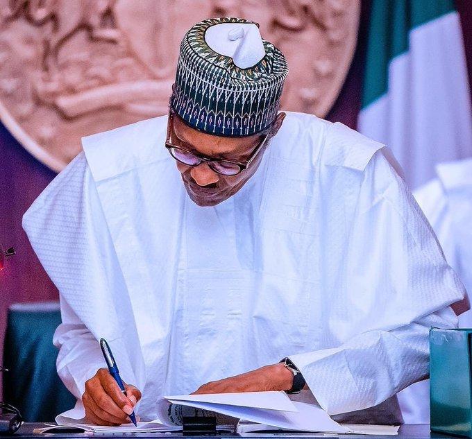 President Muhammadu Buhari signing The Nigeria Police Bill, 2020 [PHOTO: Presidency]