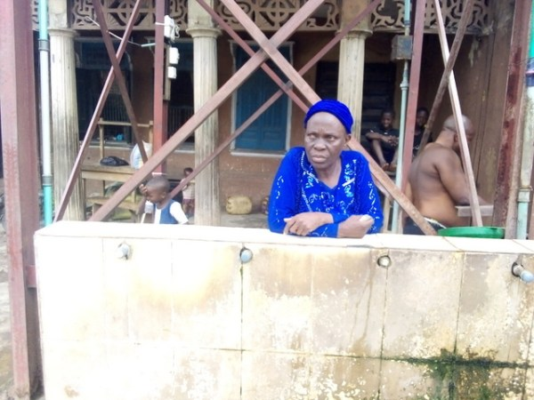 Landlady of the house where solar powered borehole project is located at Oje