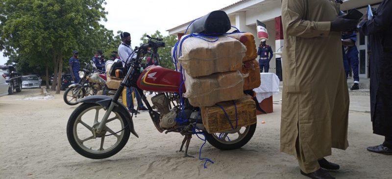 jars of fuel on motorcycle. of suspected Boko Haram 'suppliers'