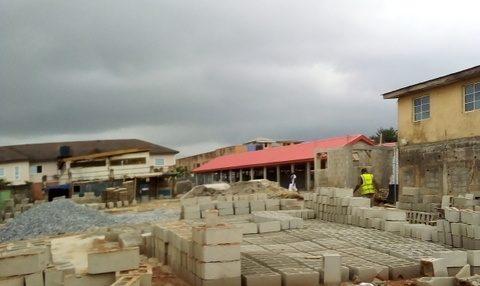 The abandoned bio-gas project, now surrounded by new kiosks. [PHOTO:  Oladeinde Olawoyin]