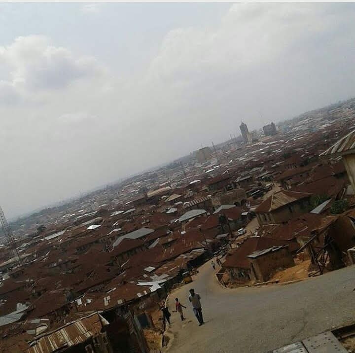 """J.P. Clark's """"Ibadan, running splash of rust and gold-flung and scattered among seven hills like broken china in the sun,"""" visualized in a picture (Credit: Yusuf Akinpelu)."""