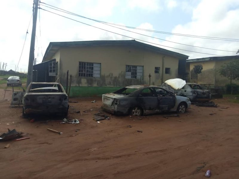 Some burnt vehicles at Oko Prison in Benin, on Tuesday