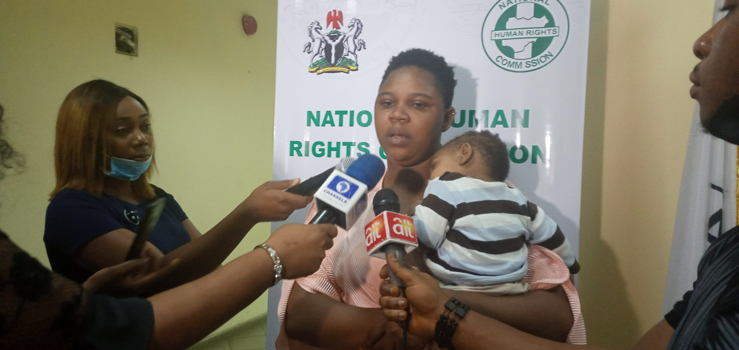 Victim's wife with her few months old baby boy