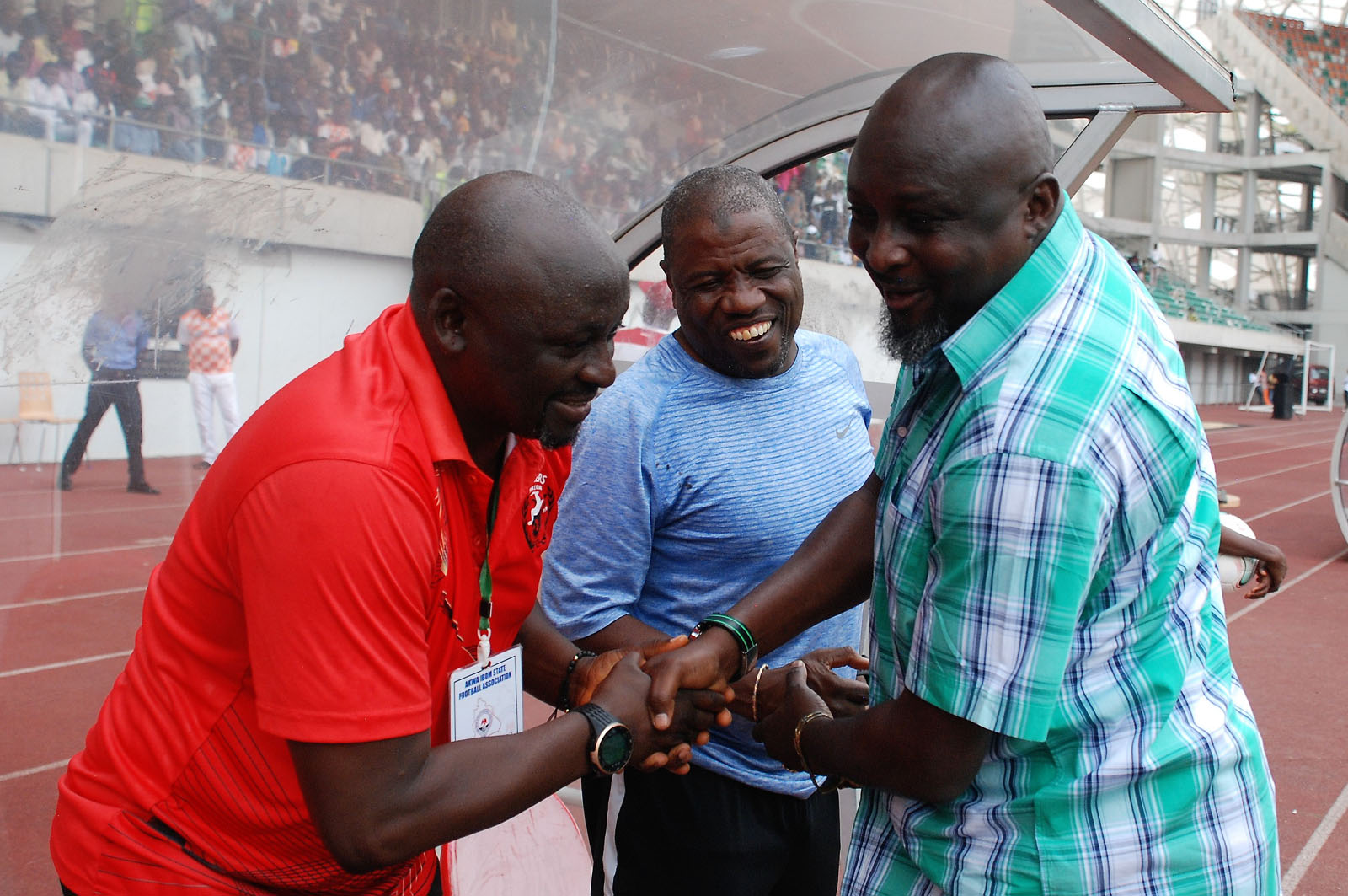Coach Kennedy Boboye of Akwa United exchange pleasantries with Rangers coaches, Salisu Yusuf and Mbwas Mangut