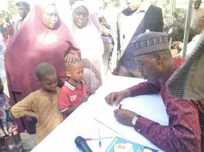 Governor Babagana Zulum with children of Internally Displaced Persons (IDPs) [PHOTO CREDIT: @GovBorno]