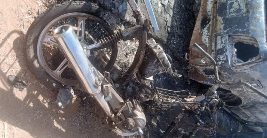 Motorcycle set ablaze by the bandits in Kaya village during the attack