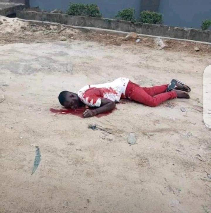 Joseph Pessu lying dead after being shot