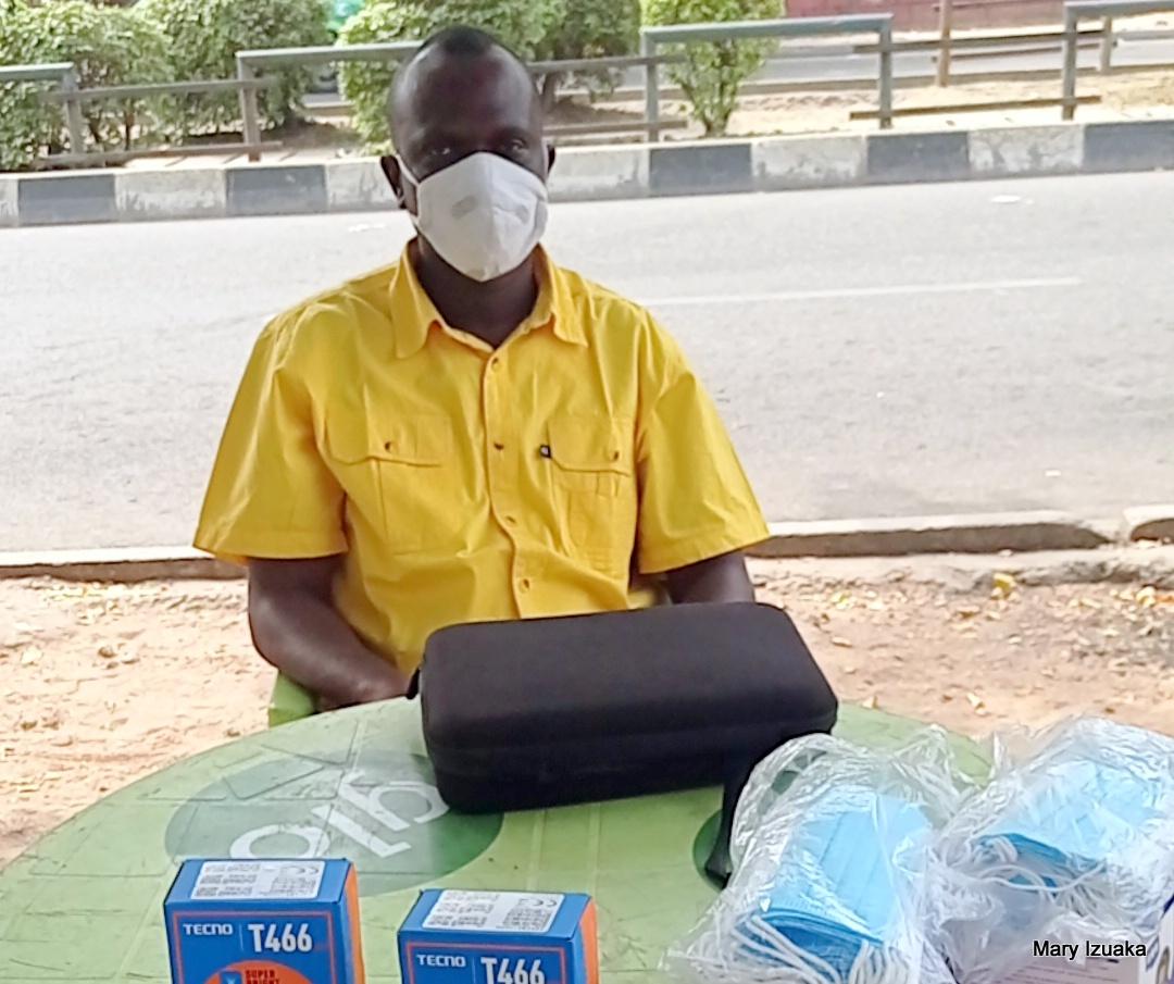 Ugo Tochukwu a SIM registration agent at Wuse market