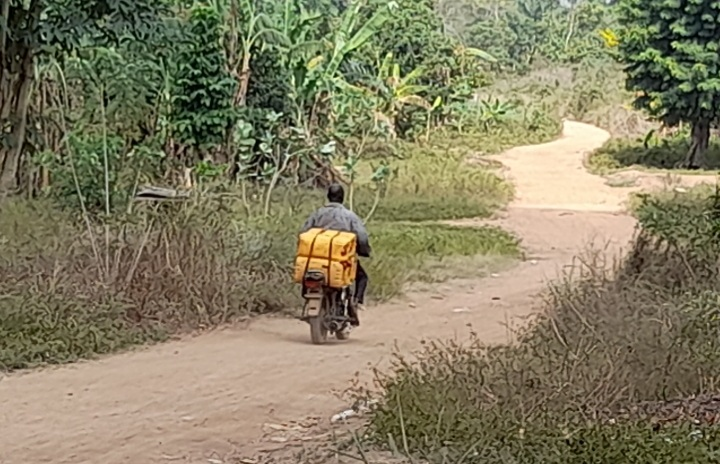 A bike man going to fetch from the stream in Oduroin