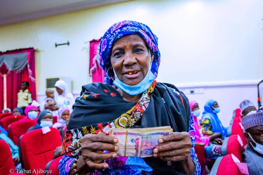 Beneficiary displays her cash grant