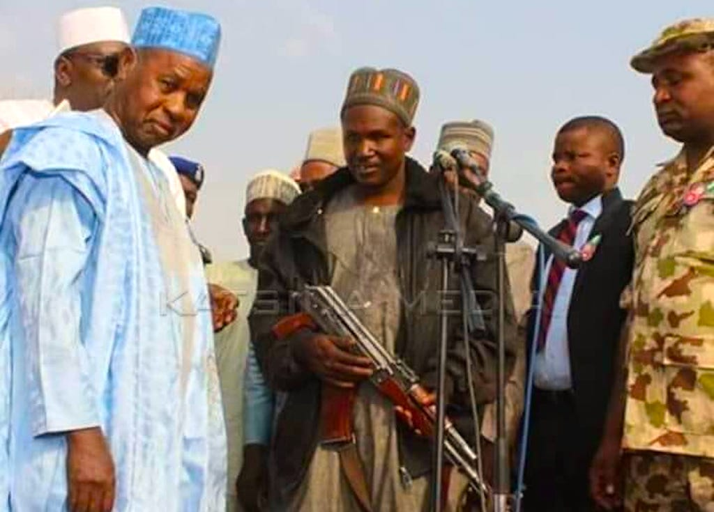 Katsina State Governor Aminu Masari in negotiation with 'militants'. Picture credit: This Day.