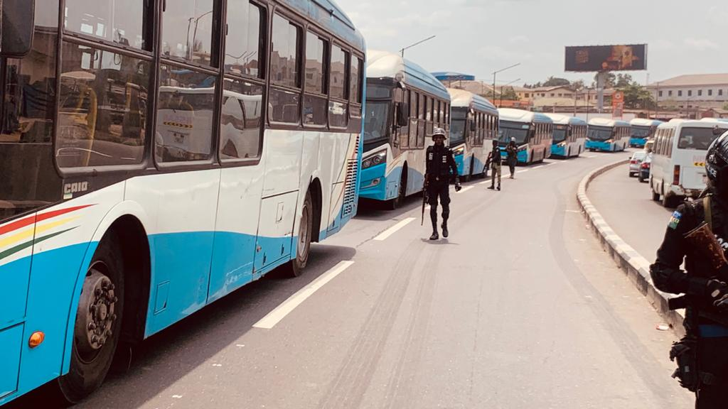 Brt buses being escorted by police officers