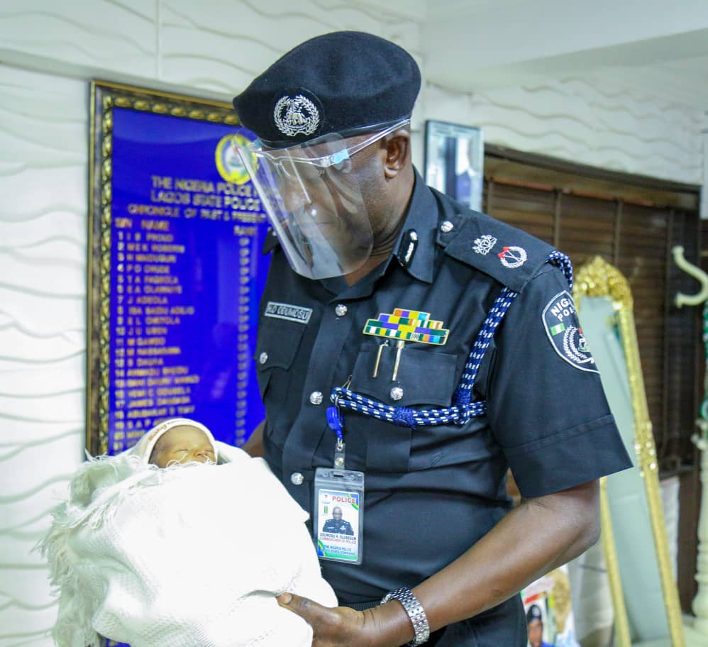 The Commissioner of Police in Lagos, Hakeem Odumosu receiving the abandoned baby.