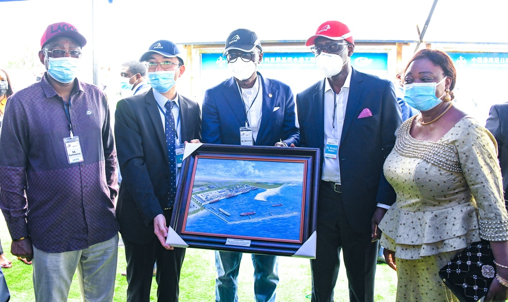L-R: Special Adviser to the Governor on Commerce & Industry, Mr. Oladele Ajayi; Managing Director, Lekki Port, Mr. Du Ruogang, presents a pictorial frame of the Lekki Port to Lagos State Governor Mr. Babajide Sanwo-Olu; Chairman, Lekki Free Zone Development Company, Mr. Abiodun Dabiri and Commissioner for Commerce, Industry & Cooperatives, Dr. (Mrs) Lola Akande, during the Governor's working visit to the Lekki Free Trade Zone, Ibeju-Lekki, on Friday, March 19, 2021.