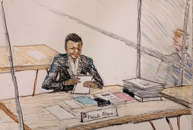 Alieu Kosiah listens to testimony during his war crimes trial. Leslie Lumeh/New Narratives