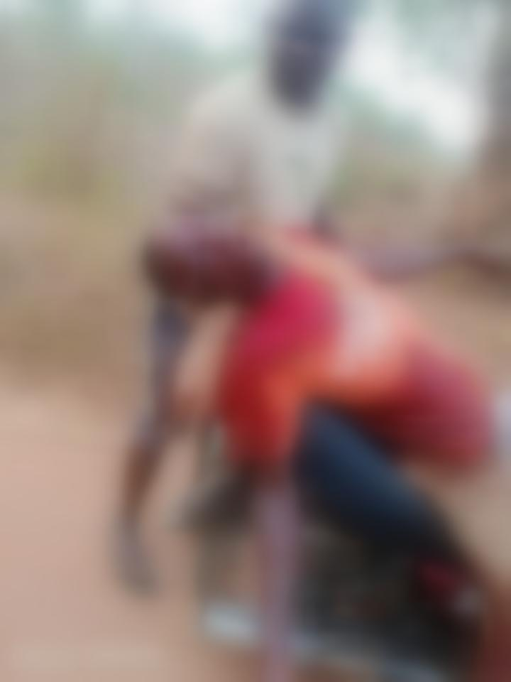A man carrying late Isiaka Apesin after he was butchered allegedly by the armed herders