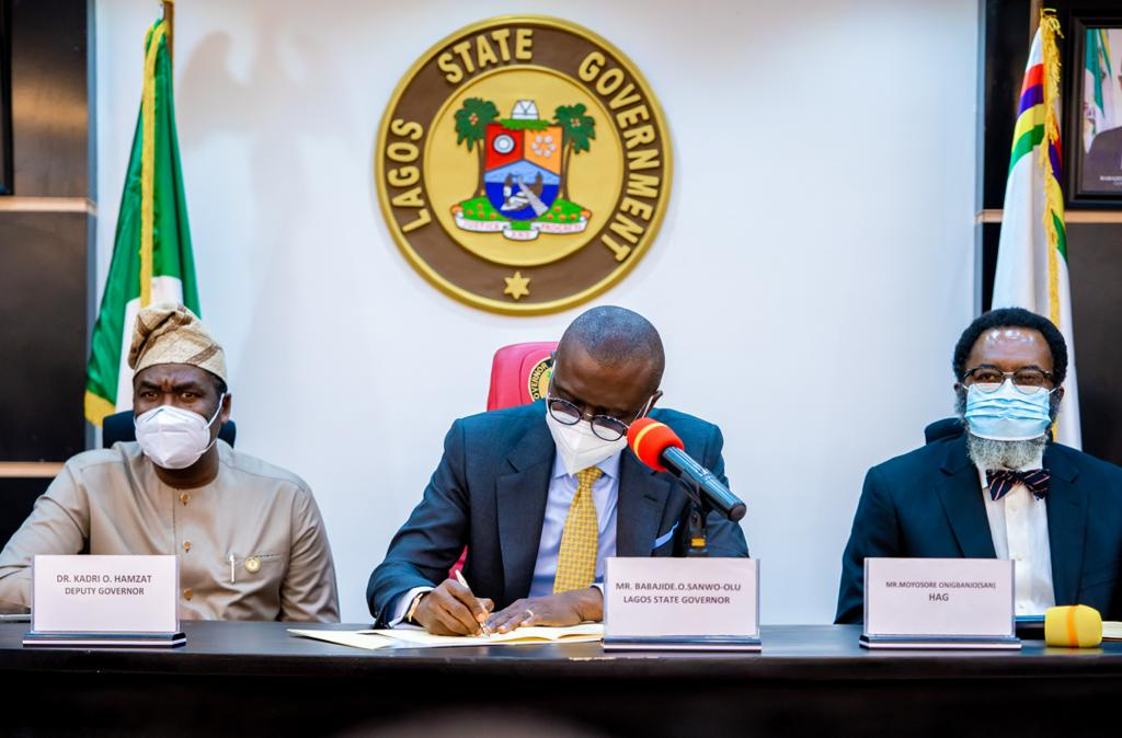 Lagos State Governor, Mr. Babajide Sanwo-Olu signing bills into Law: the Lagos State Lotteries & Gaming Authority and the Public Complaints & Anti-Corruption Commission, flanked by the Deputy Governor, Dr. Obafemi Hamzat (left) and Attorney General/Commissioner for Justice, Mr. Moyo Onigbanjo, SAN (right), at the Conference Room, Lagos House, Ikeja, on Monday, April 19, 2021.