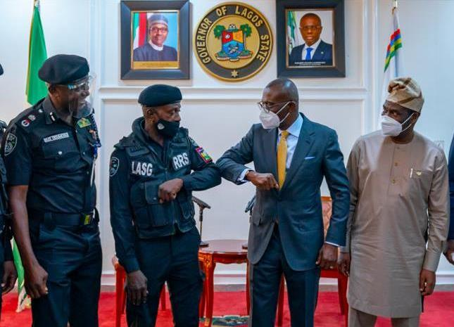 L-R: Commissioner of Police, CP Hakeem Odumosu; Police officer assaulted by traffic offender, ASP Sunday Erhabor; Lagos State Governor, Mr. Babajide Sanwo-Olu and his deputy, Dr. Obafemi Hamzat, during a ceremony to honour Erhabor at Lagos House, Ikeja, on Monday, April 19, 2021.
