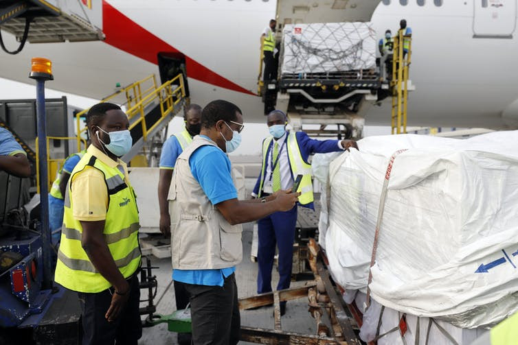 The first shipment of COVID-19 vaccines distributed by COVAX arriving in Ghana. Francis Kokoroko/UNICEF/AP.