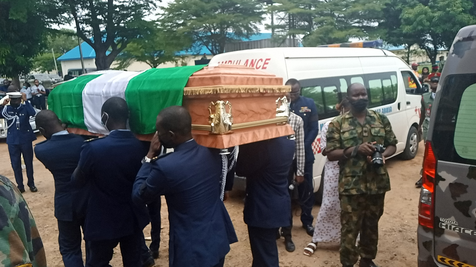 The Caskets of each Officer is being carried to their respective ambulances