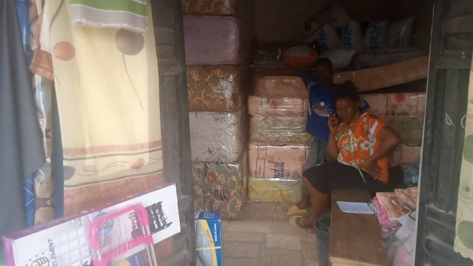 Ms Nwokoro and one of her children inside her shop