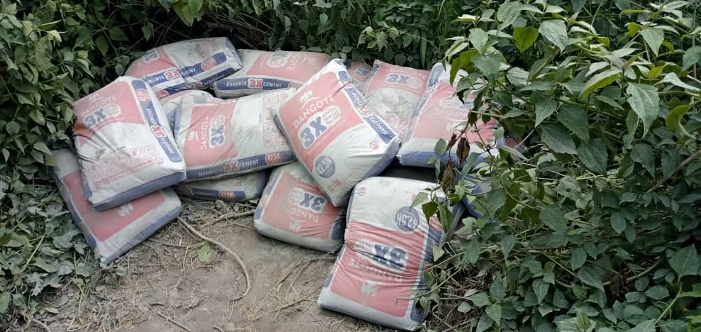 Some of the bags of cement stolen by the tricycle operators