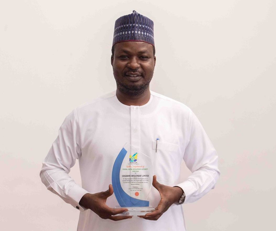 Chairman, Cosgrove Investment Limited, Mr Umar Abdullahi poses with the plaque of appreciation bestowed by FCDA
