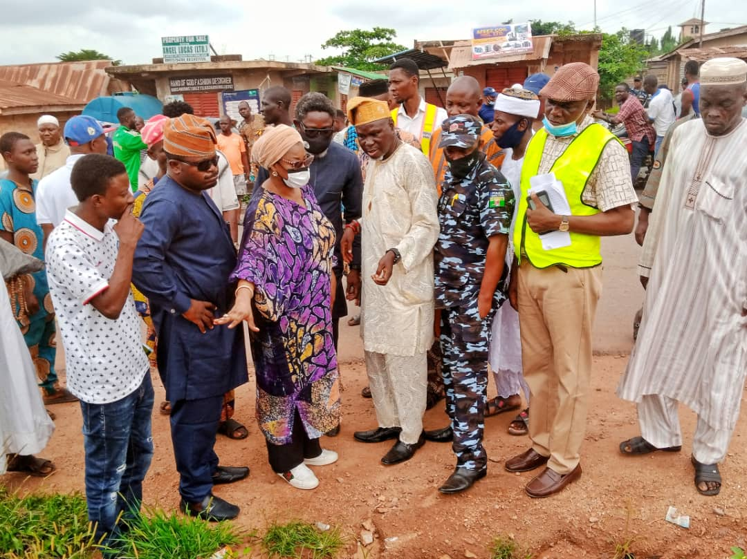 Hon. Tolu Akande-Sadipe flanked by officials of the Ministry of Works and community members during the inspection