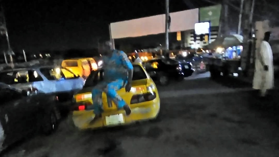Taxi drivers awaiting passengers at University of Suya, Allen Roundabout