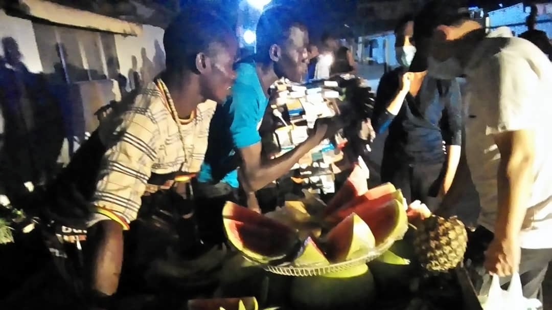 Keke Driver, Fruit seller, and others at Toyin Area