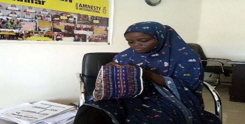 This is Zainab Ali embroidering a Bama cap. She embroiders and sell the cap at the rate of N7,000 to N10,000 every month.