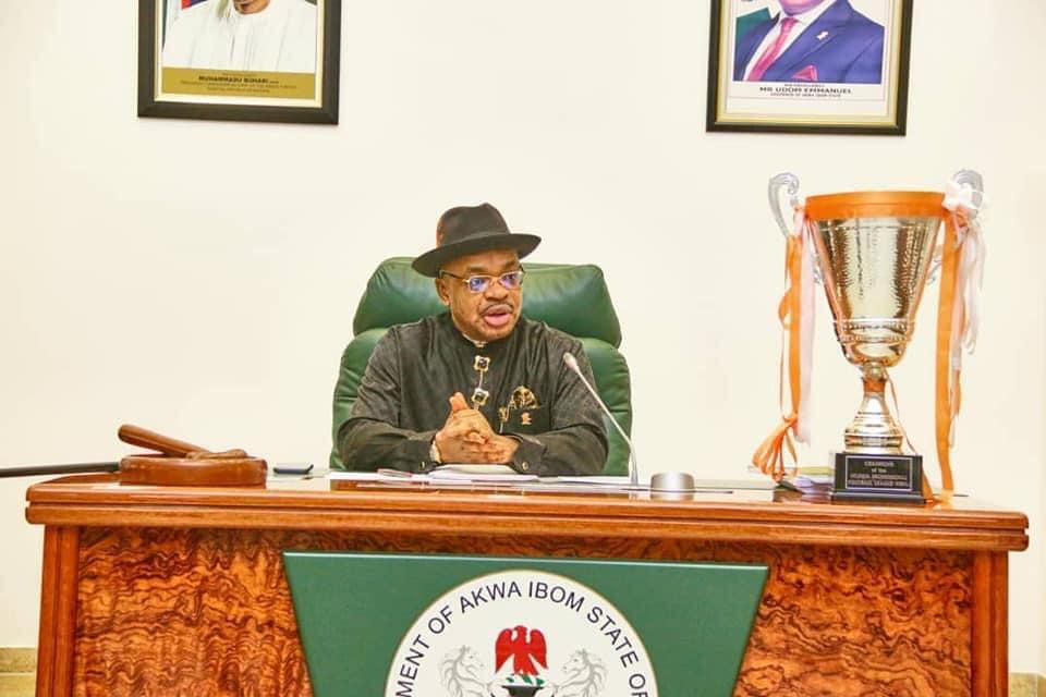 Governor Emmanuel has the trophy displayed before him
