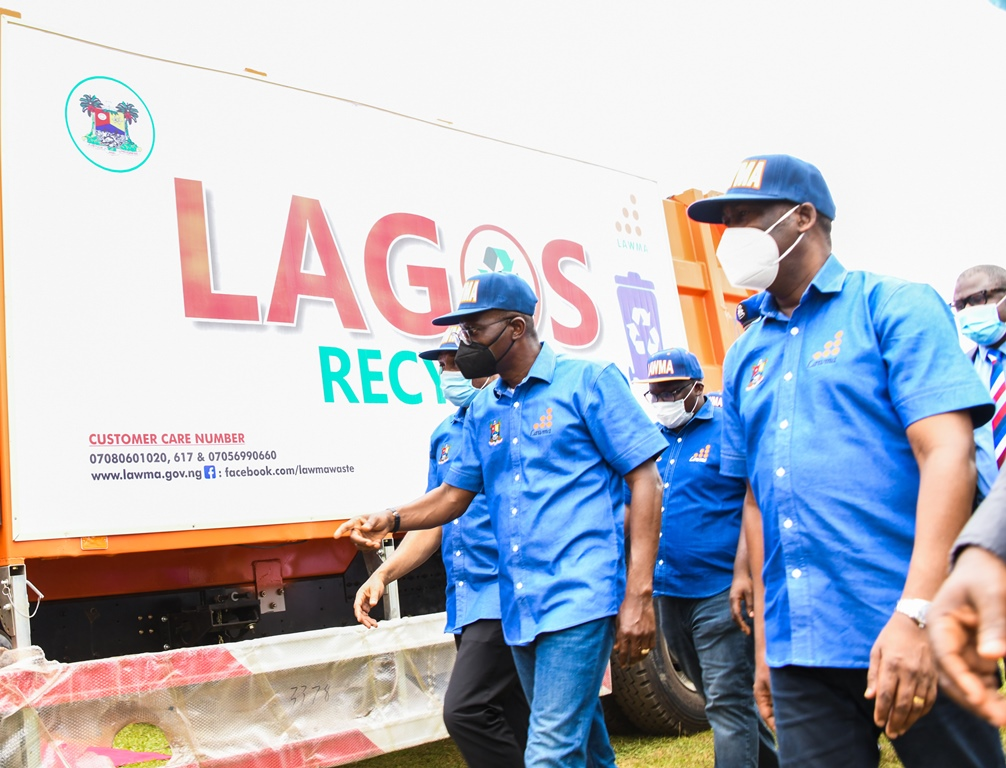 R-L: Lagos Deputy Governor, Dr. Obafemi Hamzat; Governor Babajide Sanwo-Olu and Commissioner for the Environment & Water Resources, Mr. Tunji Bello, during the commissioning of 102 brand new compactor trucks and 100 Double Dino Bins for LAWMA at Lagos House, Ikeja, on Wednesday, August 4, 2021.