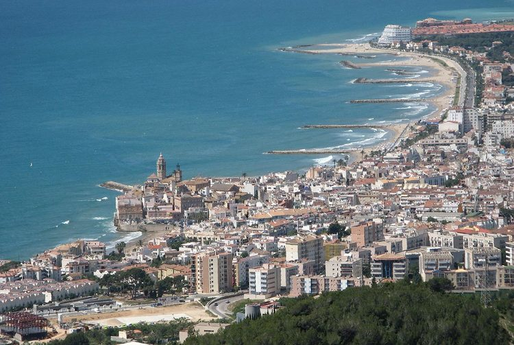 An aerial view of the seaside town of Sitges, outside Barcelona. [Credit: Werner Lang/WikiMedia Commons]