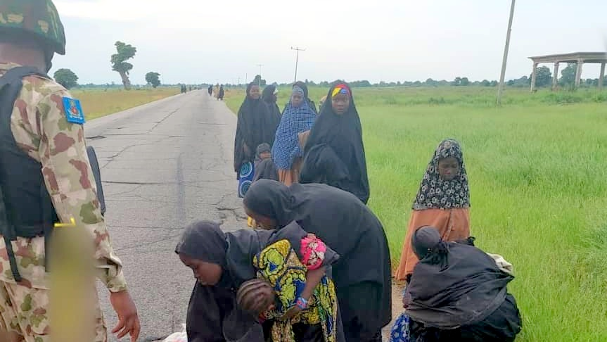 Boko Haram terrorists and their family surrender to Nigerian troops CREDIT: Nigerian Army