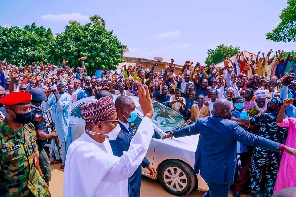 Buhari Waves at cheering crowd in Bichi Emirate Kano State