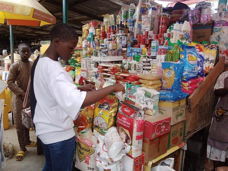 A trader in ogba market, Lagos state (PHOTO CREDIT: Ntiedo Ekott)