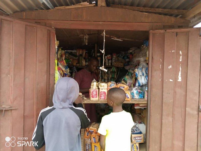 Bread seller in kubwa, Fct, Abuja (PHOTO CREDIT: Ntiedo Ekott)