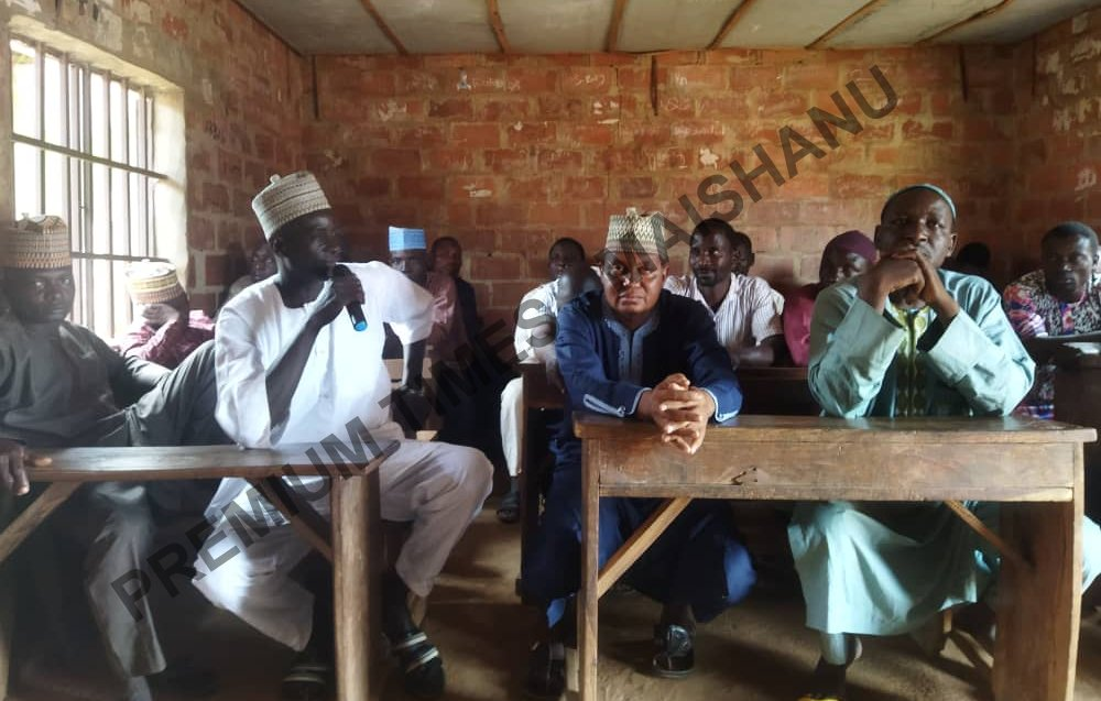 Surajo Abdullahi, the head of ransom appeal committee at the meeting, (in white dress with microphone)
