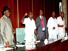 Labour leaders singing solidarity song before the commencement of the meeting with president Goodluck Jonathan