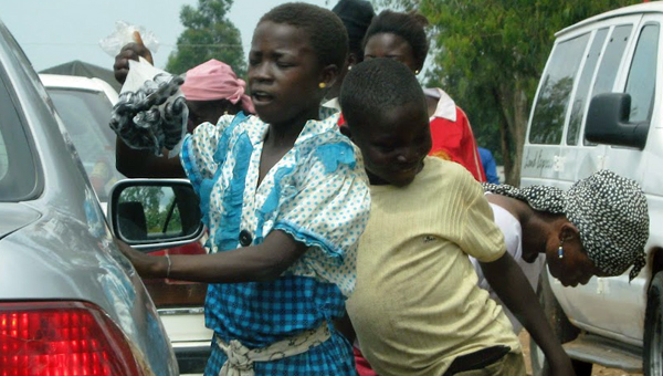 Children selling on Abuja-Jos highway, Nigeria.