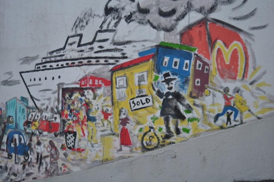 an anti-gentrification mural in lisbon