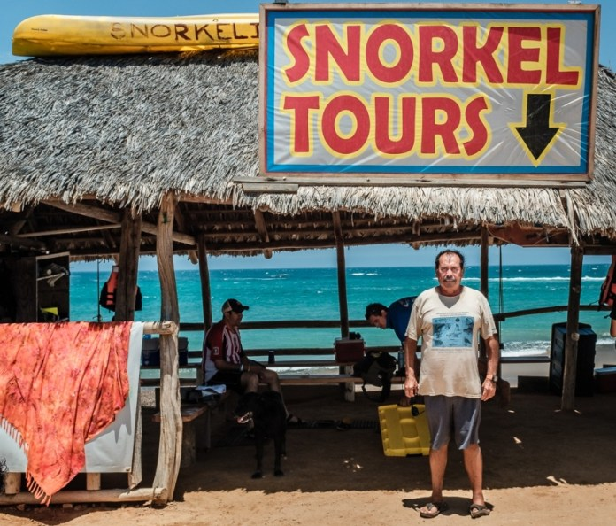 Mario Castro stands in front of his dive shop in Mesico