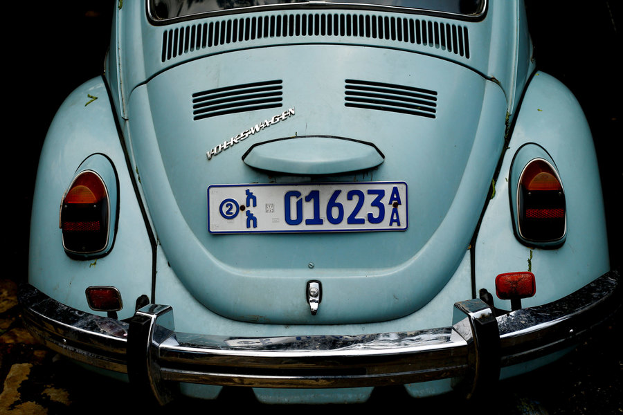 The rear end of a light blue Volkswagen Beetle car is shown with an Ehtiopian license plate.