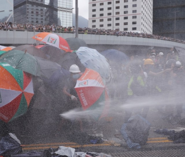 Protesters Are Hit By Police Water Cannon During A Demonstration Against A Proposed Extradition Bill In Hong Kong China June 12 2019