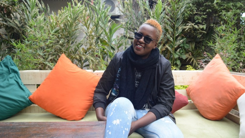 Ugandan rapper Keko relaxing in a cafe in Kampala.
