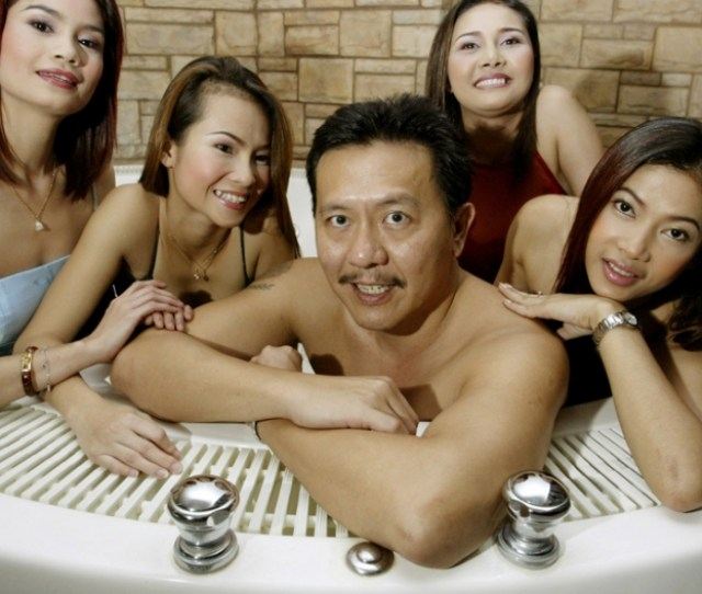 Thailands Massage Parlour Tycoon Chuwit Kamolvisit C Poses In A Jacuzzi Inside Copa Cabana One Of His Six Upscale Entertainment Clubs In Bangkok On
