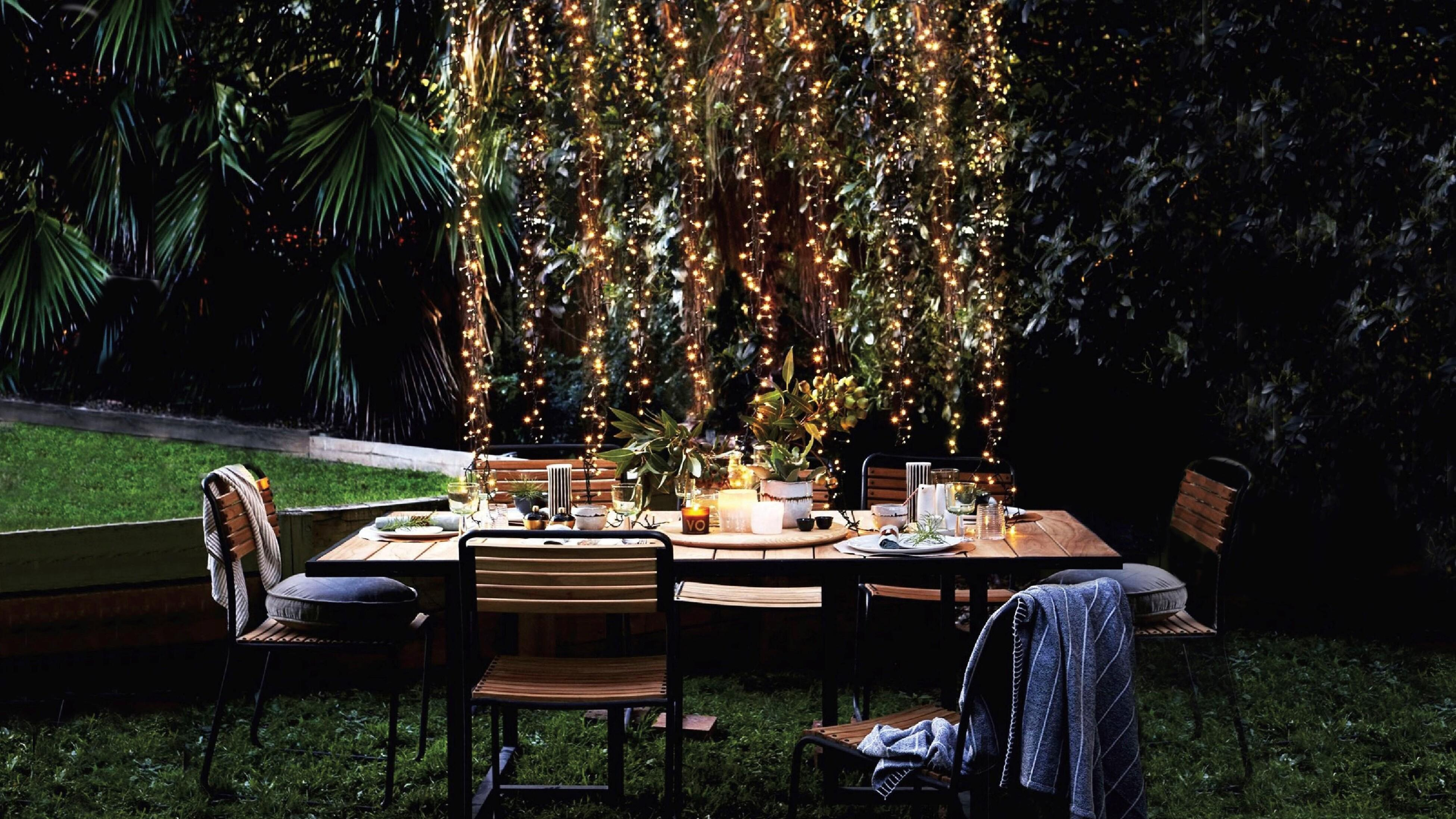 https www bunnings com au diy advice home improvement lighting electrical transform outdoor spaces with string lights