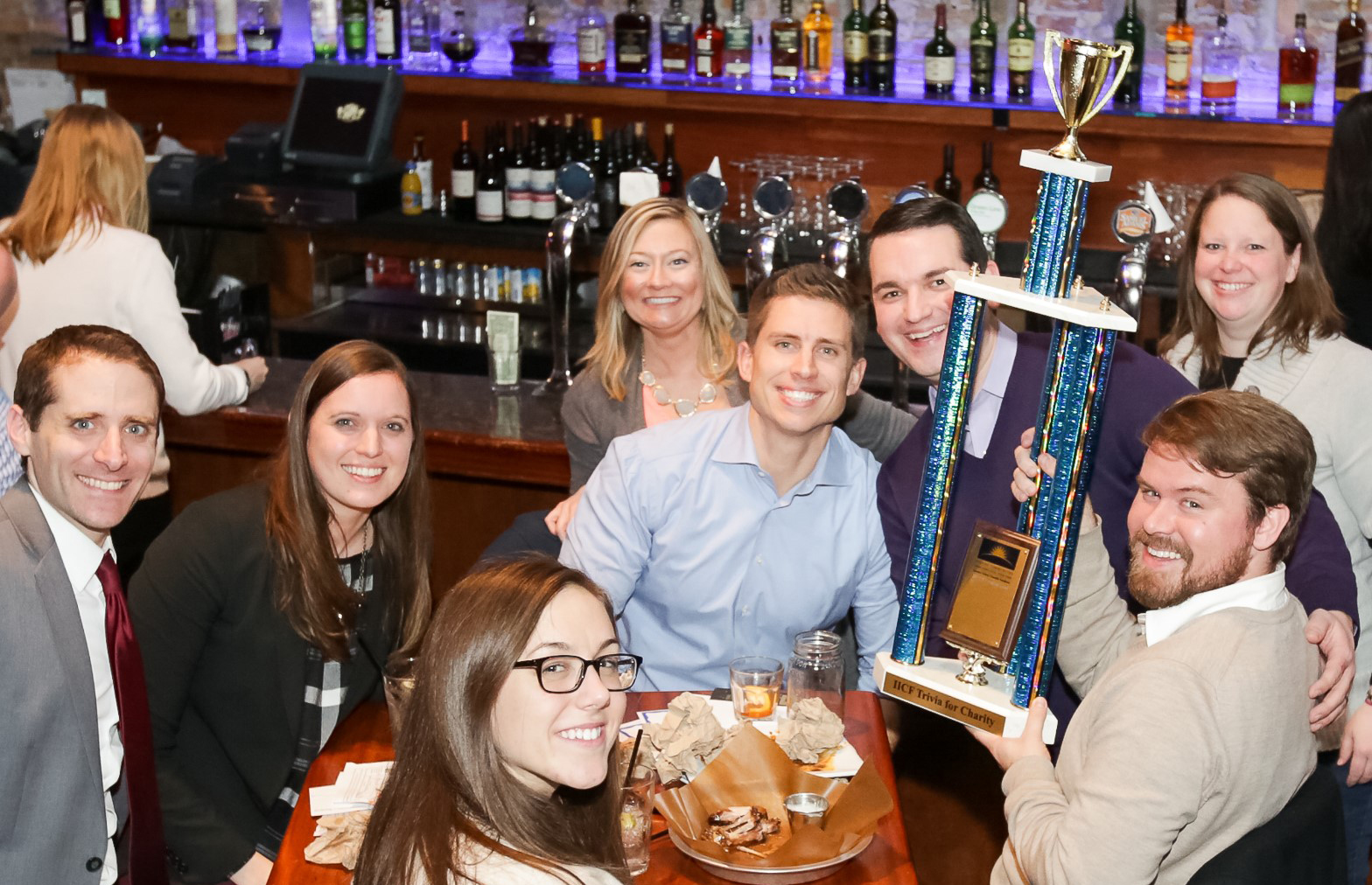 Winners-of-trivia-contest-holding-trophy